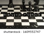 Small photo of Brute Force the word or concept represented by black & white letter tiles on a chessboard