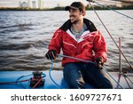 Young Sailor In Cap Holds And...