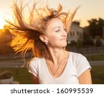 blonde female with hair flying... | Shutterstock . vector #160995539
