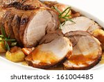 Small photo of roasted pork on white plate