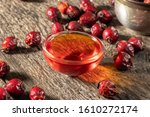 A Bowl Of Rosehip Seed Oil With ...