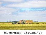Harvesting Silage Bales Of...