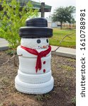 White Tire Snowman With A Black ...