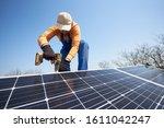 Man Worker Installing Solar...