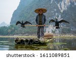 A Fisherman Hold A Stick Which...