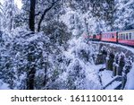 Small photo of Shimla, Himachal Pradesh / India - January 09 2020: The Kalka–Shimla railway is a 2 ft 6 in narrow-gauge railway in North India which traverses a mostly-mountainous route from Kalka to Shimla.