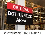 Small photo of Critical Bottleneck Area sign in industrial factory setting