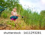 Little Girl Fishing On The Lake