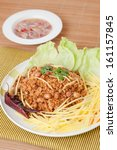 """Small photo of Crispy catfish with green mango salad or """"yum pla dook foo"""" is a quick Thai salad appetizer."""