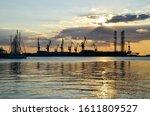Cranes In Shipyard At Sunset....