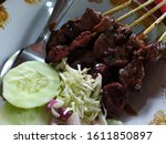 goat satay with cabbage  onion  ...