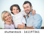 happy beautiful family posing... | Shutterstock . vector #161197361