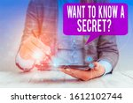 Small photo of Word writing text Want To Know A Secret Question. Business concept for to divulge a confidential vital information Female human wear formal work suit presenting presentation use smart device.