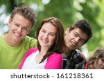 four smiling teenagers posing... | Shutterstock . vector #161218361