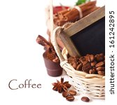 Chocolates and coffee beans in a basket with chalkboard for text. - stock photo