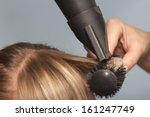 hairdresser dries the hair in a ... | Shutterstock . vector #161247749