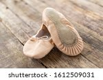 Ballet shoes  laying on rough...