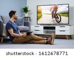 man streaming television...   Shutterstock . vector #1612678771