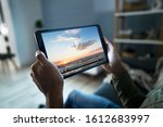 cropped image of man watching... | Shutterstock . vector #1612683997