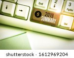 Small photo of Word writing text 2019 Summary. Business concept for brief comprehensive especially covering the main points of 2019 White pc keyboard with empty note paper above white background key copy space.