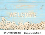 Word Welcome By Wooden Letters...