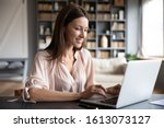 Happy Young Woman Sit At Desk...