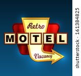 Retro Motel Road Sign With An...
