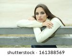 young lonely woman on bench in... | Shutterstock . vector #161388569