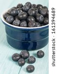 Blueberries - Delicious juicy blueberries on a blue wooden table. - stock photo