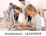 young girl in office working on ... | Shutterstock . vector #161444039