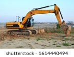 Excavator Digs The Ground For...