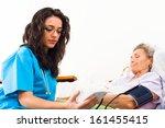 nurse using digital blood... | Shutterstock . vector #161455415