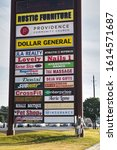 Small photo of Humble, Texas/USA 11/20/2019: Vertical signpost advertising many local businesses in a strip mall in Houston, TX by the roadside of FM 1960.