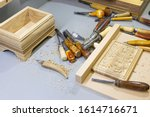 Small photo of Craftsman carving a souvenir from wood