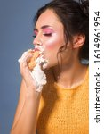 caucasian girl eat cupcake. was ...   Shutterstock . vector #1614961954