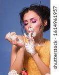 caucasian girl eat cupcake. was ...   Shutterstock . vector #1614961957