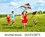 Group Of Four Kids Running In...