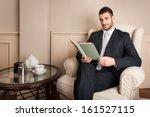 young businessman relaxing... | Shutterstock . vector #161527115