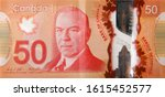 Small photo of William Lyon Mackenzie King portrait on Canada 50 Dollars 2012 Polymer Banknote fragment