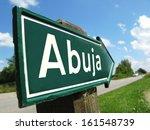 Small photo of Abuja signpost along a rural road