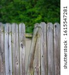 A Broken Wooden Fence With A...