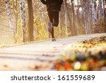 runner run in park during autumn   Shutterstock . vector #161559689