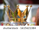 Small photo of Miami Beach, FL, USA - December 15, 2019: Shiny, luxurious golden crown of English Premier Cup football/soccer trophy on display