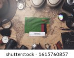 zambia flag between traveler's... | Shutterstock . vector #1615760857