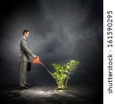 image of businessman watering... | Shutterstock . vector #161590295