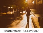 man walking in the street on a... | Shutterstock . vector #161593907