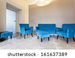 Original blue sofa, armchairs and pouf in living room - stock photo