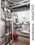 Heating pipes system in a boiler room, vertical - stock photo