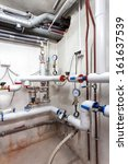Vertical view of a heating pipes system in a basement - stock photo