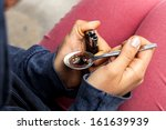 young woman with a lighter and... | Shutterstock . vector #161639939